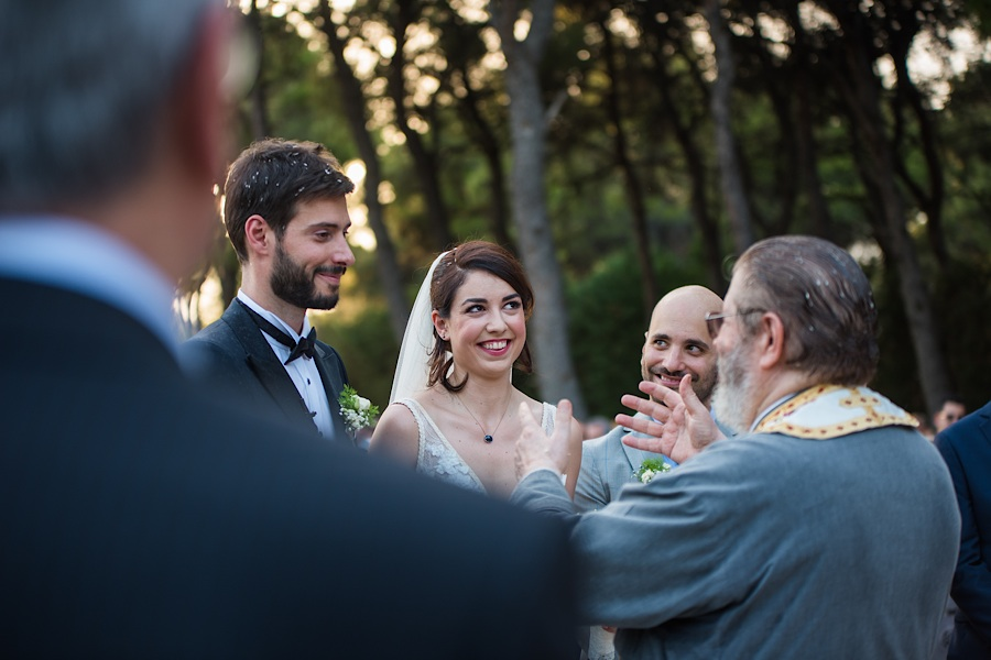 042 Destination wedding in greece athens at riviera estate bride groom first kiss ceremony photography - An elegant wedding in Athens